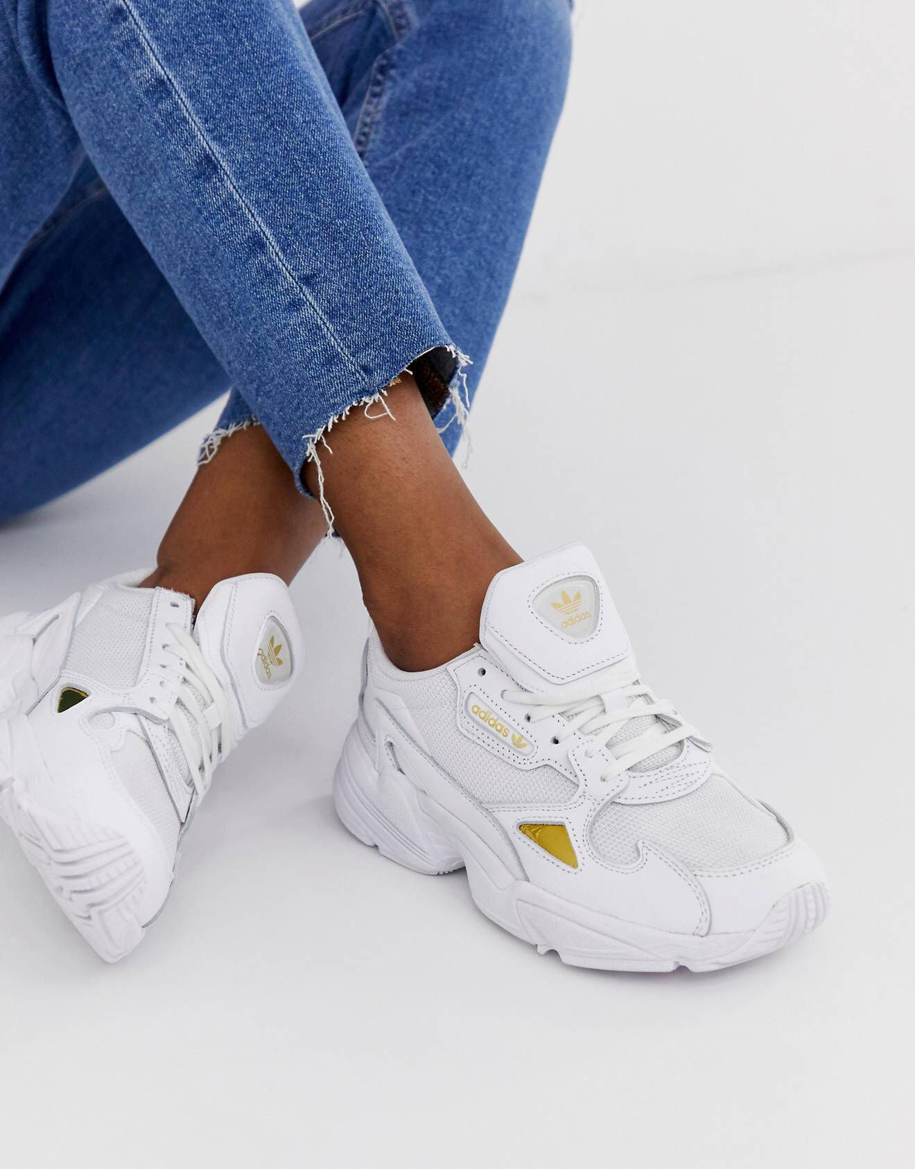69ec6a155 adidas Originals Falcon trainers in white and gold in 2019