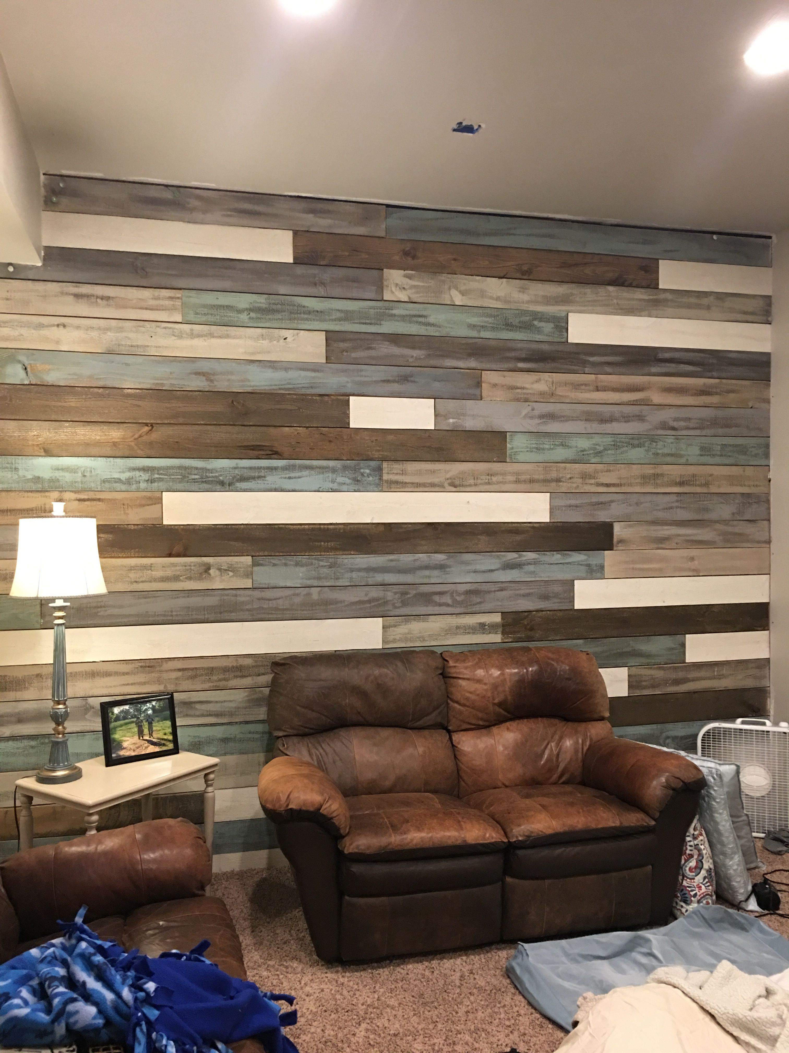 wood wall living room walls decor furniture and cabinet paint home how about a using 1 67 fence boards rethunk junk this was done cotton sandstone seaside blue grass driftwood