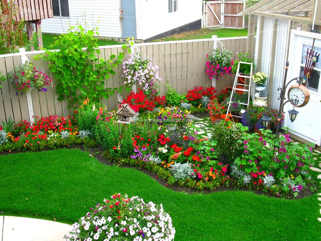 From tootsie time i love the backyard flower garden red for Landscaped back gardens