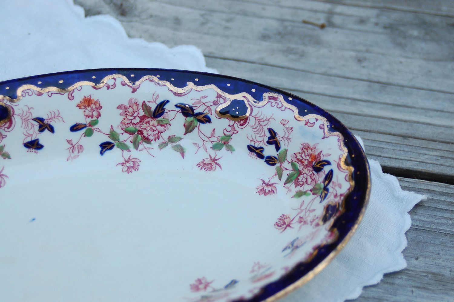 Vintage 1920s Regal Pottery Co. navy, pink and gold small floral dish, English pottery. $15.00, via Etsy.