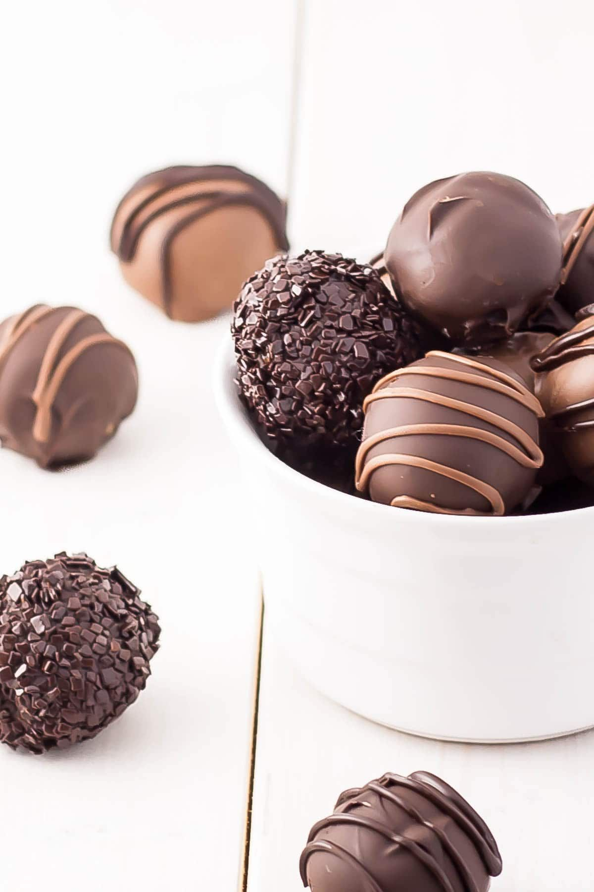 Cookie Dough Truffles - Perfectly poppable bites of cookie dough dipped in chocolate. Eggless and no bake.   livforcake.com