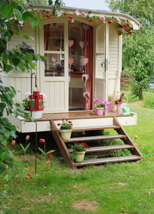 a camper with a back porch? I just died from the cuteness. This would make a great playhouse too!