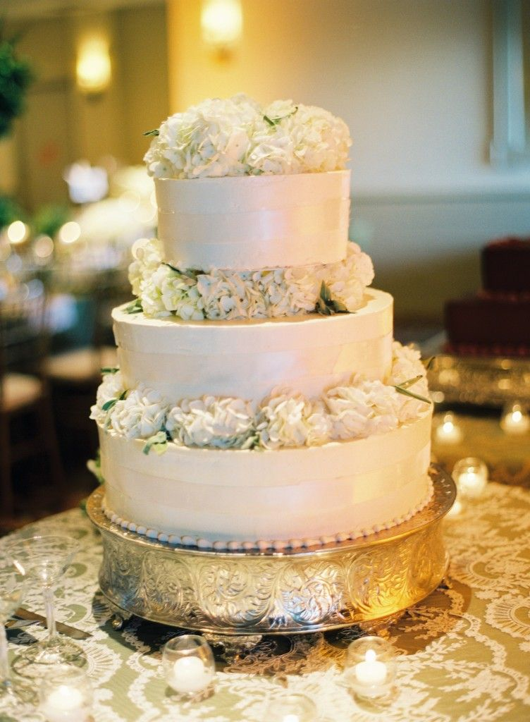 White floral Wedding Cake. Like the flowers between the top layer ...