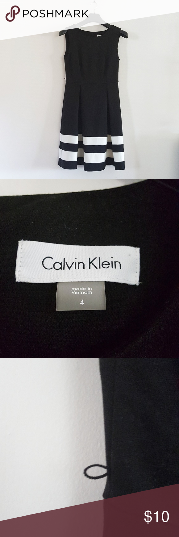 Calvin Klein dress Pleated dress with white striped skirting...sleeveless. Belt loops but missing belt. Belt can be replaced with coordinating belt oy just cut loops. Calvin Klein Dresses Mini