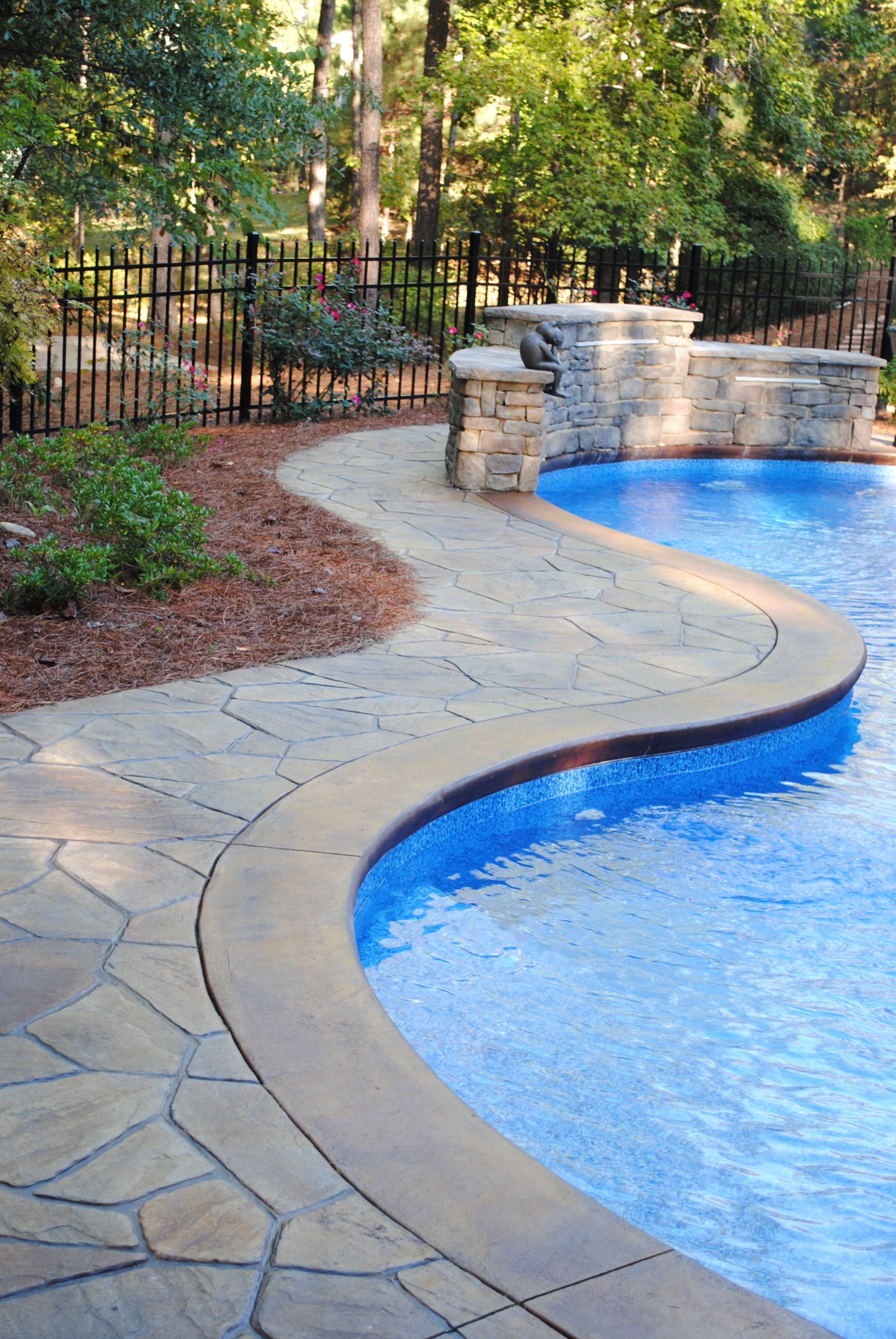 Stamped concrete flagstone pattern with stained concrete for Pool design pattern