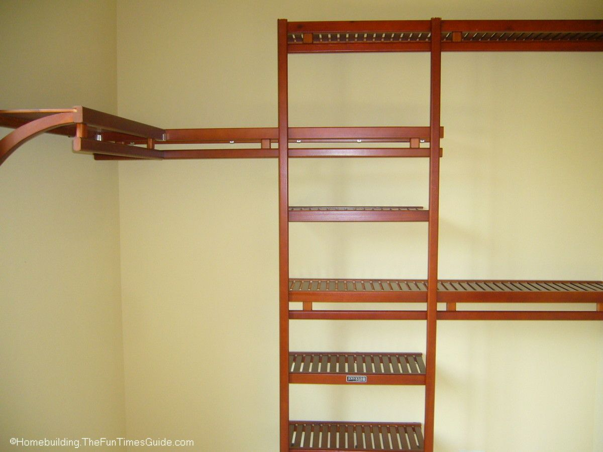 Spruce Up Your Walk In Closet With A Wood Organizer Instead Of Wire Shelving