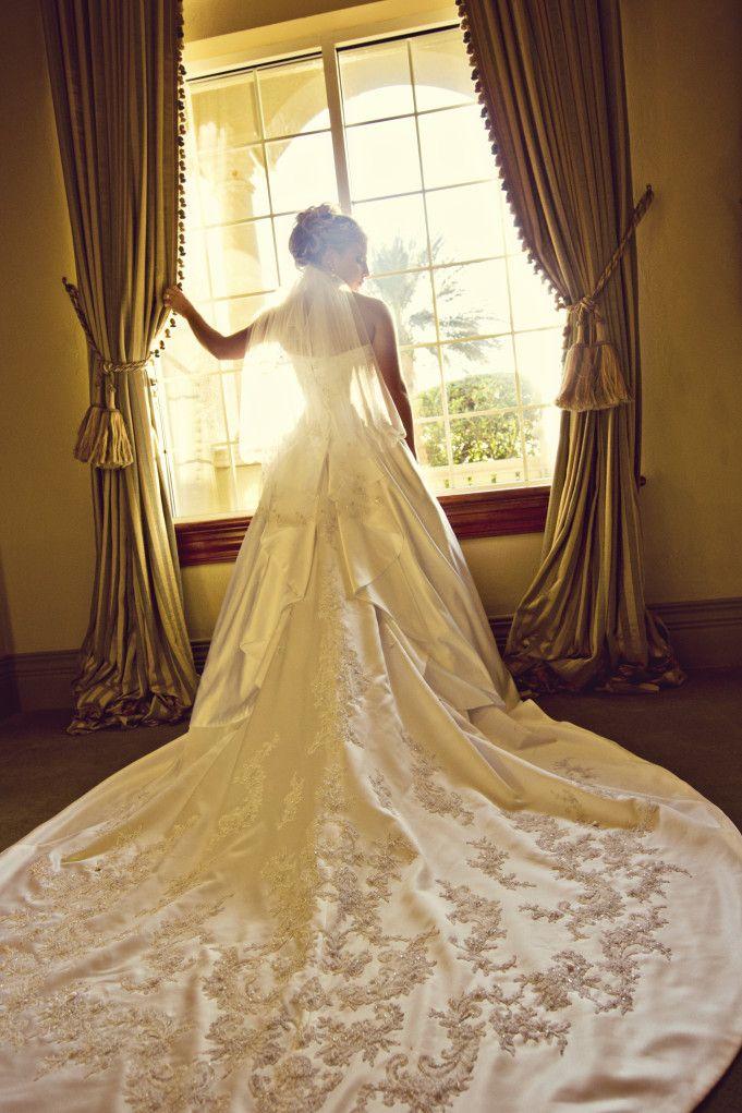 Elegant wedding dress with long train by Steph Jones Photography