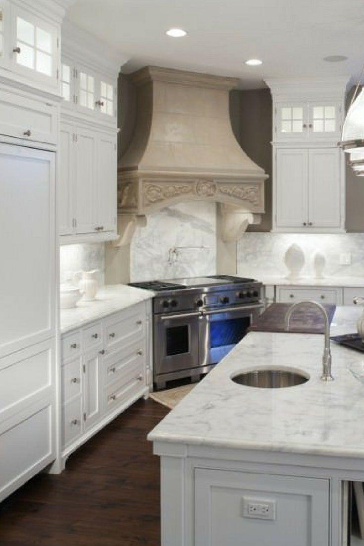 Style white kitchen with dark wood flooring
