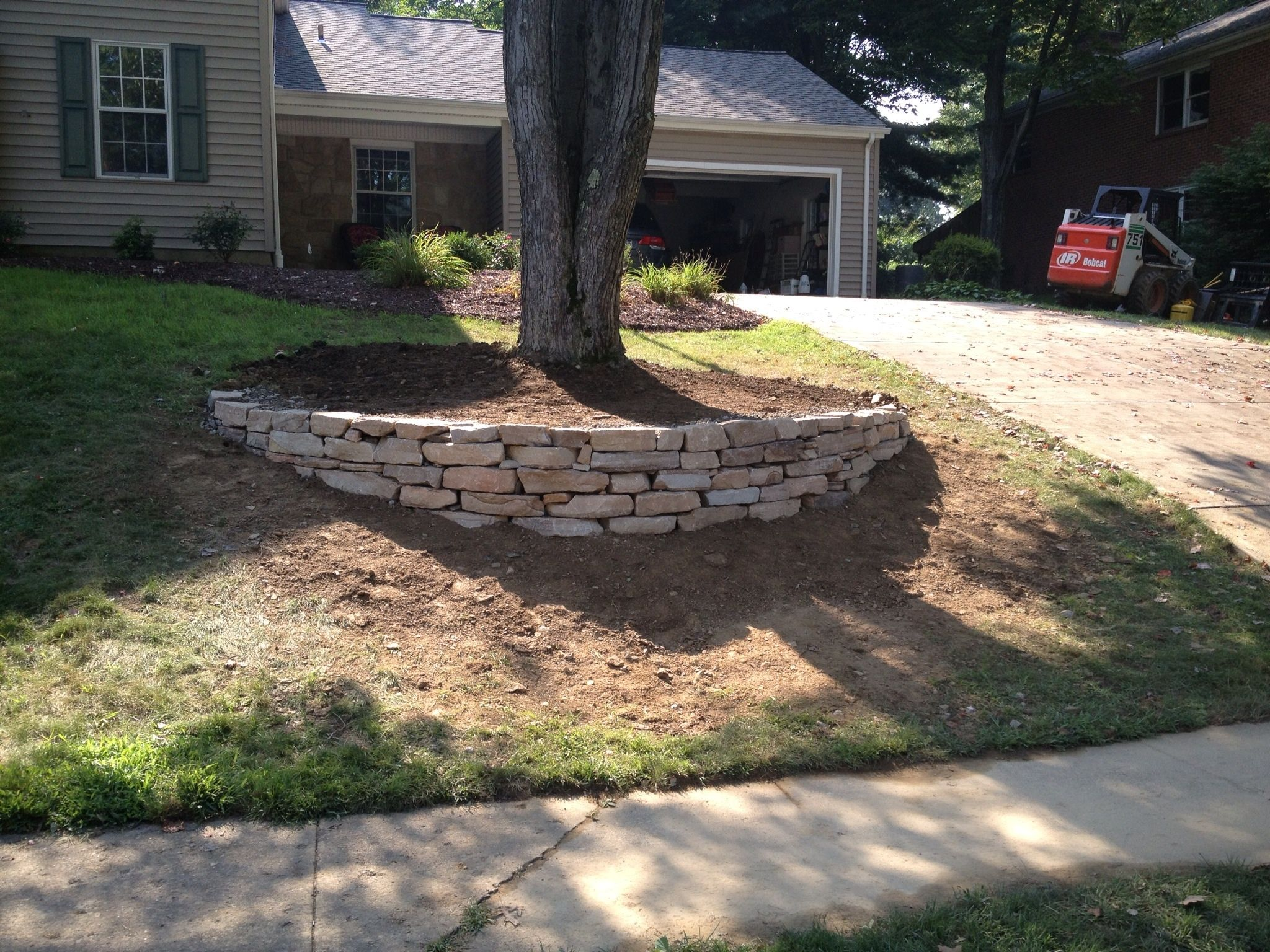 We Built The First Wall Front Yard Landscaping Design Backyard Landscaping Backyard Landscaping Designs