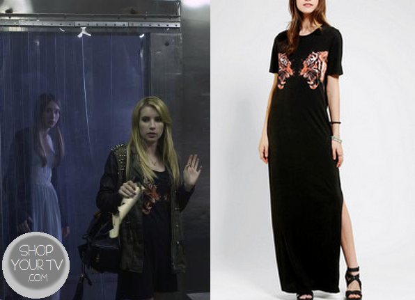 d70501a856a ... (Emma Roberts) wears this black maxi dress with 2 lion tiger heads on  the front and a slit down the leg