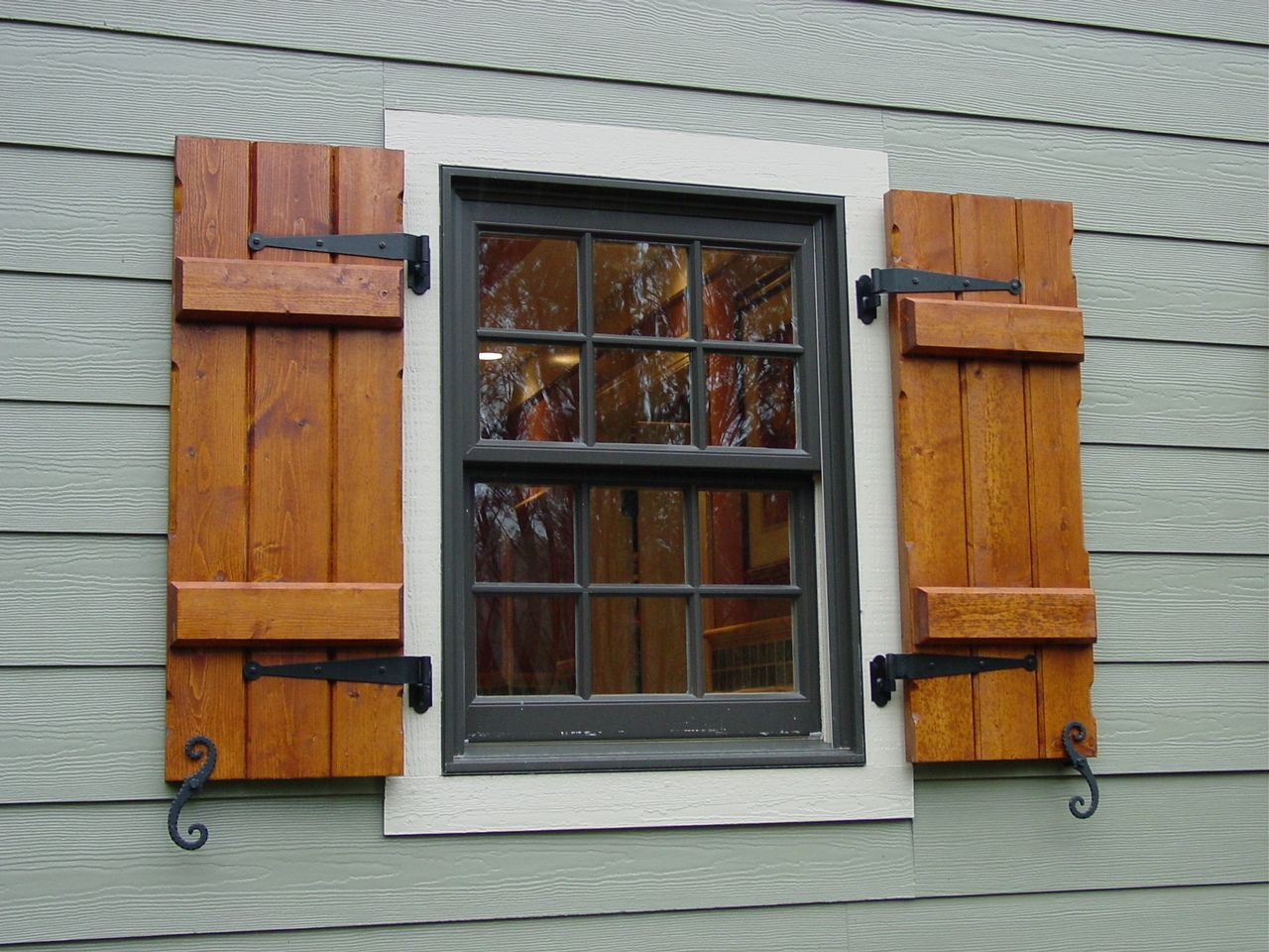 Wooden Window Shutters : Hand stained board batten shutters with black hardware