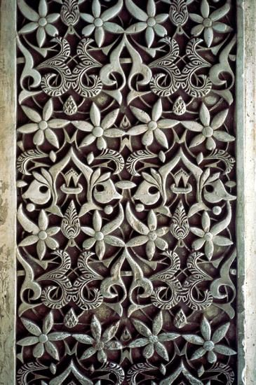This is stucco and plasterwork rather than tile, but the