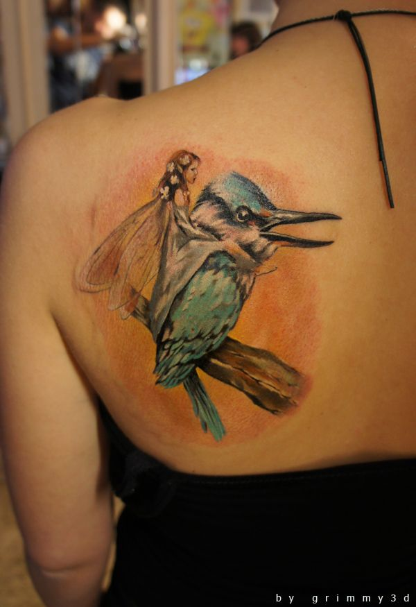 want something like this... only on a hummingbird.. and the fairy would have butterfly-like wings - to represent my mom, and both grandmothers.