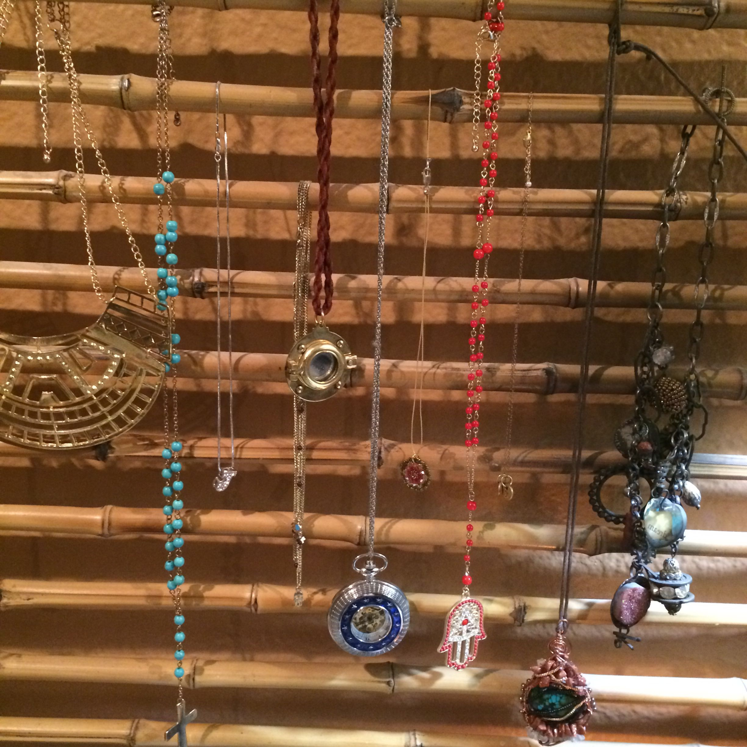 Love hanging necklaces on this frame made from rows of bamboo.