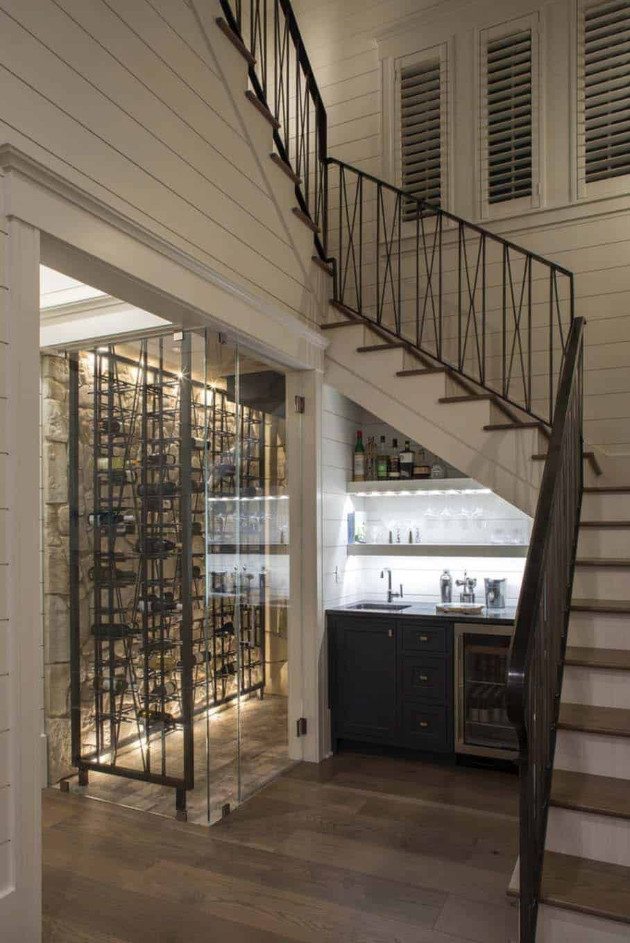 Incredible Beach House In Watercolor Showcases Airy Coastal Vibe Glass Wine Cellar Under Stairs House Of Turquoise