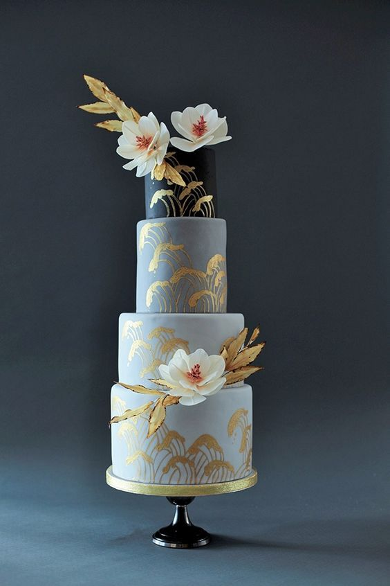 "Designed by Victoria Made, this striking Japanese-inspired #cake features glinting hand-painted waves reminiscent of those found in woodblock prints of the ukiyo-e, or ""floating world,"" school. Intricately crafted out of sugar, lotus-like blooms and bamboo-style leaves with charred edges and pale ochre hues complement where green foliage would clash."
