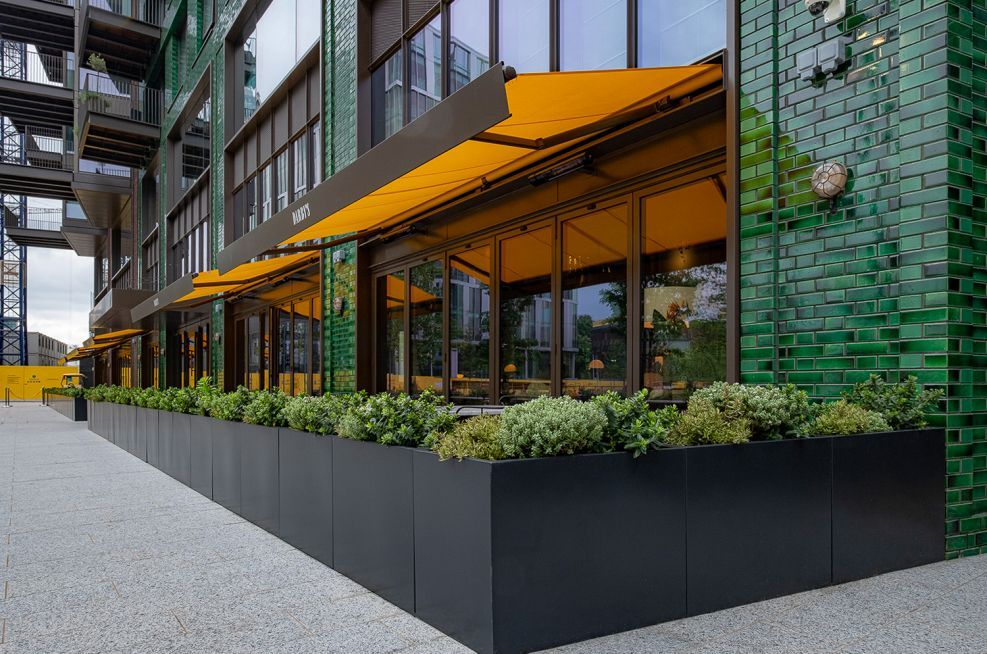 Public Realm Bespoke Manufactured Steel Planters At Darby S Restaurant Embassy Gardens Steel Planters Restaurants Outdoor Seating Restaurant Planters