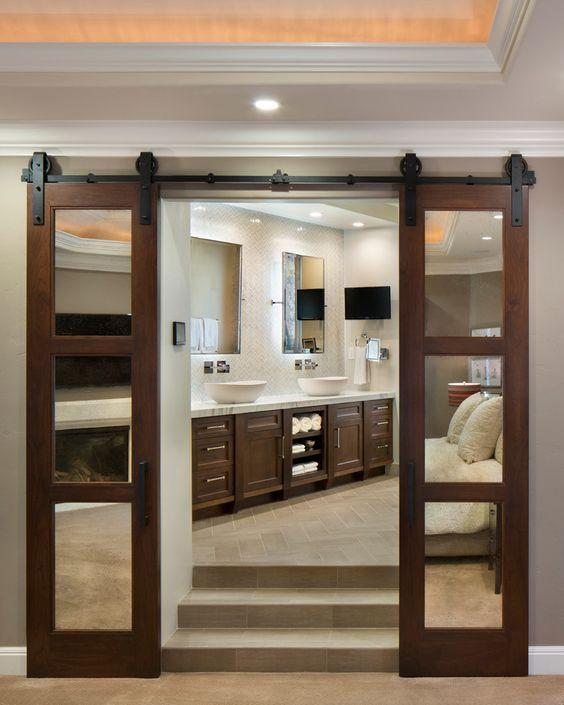 All one door with 6 mirrored panes. Door from bedroom to bath.