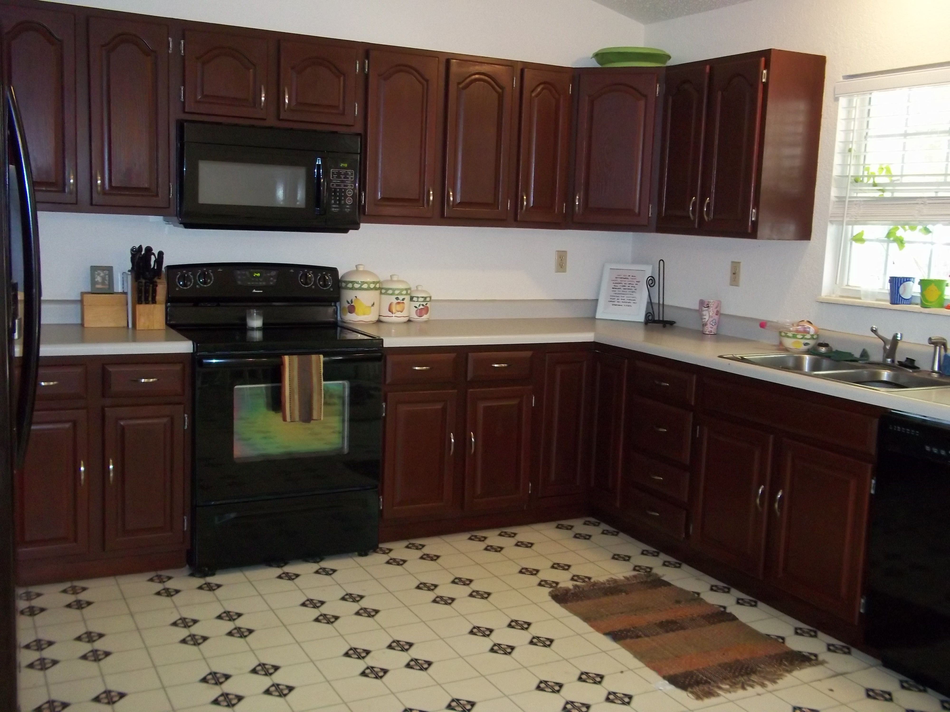 Kitchen Cabinets after we refinished them with Rustoleum ...