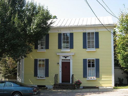 yellow house, blue shutters, red door | exterior house colors