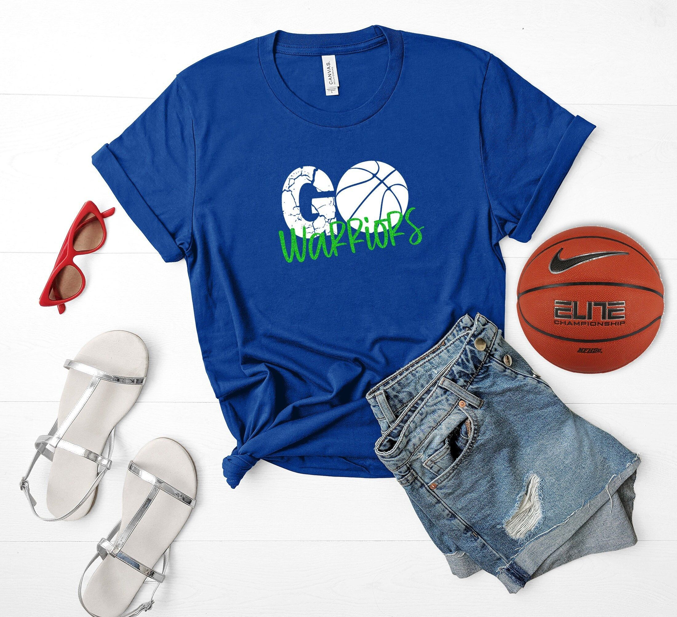 """""""Customize a basketball shirt for your school basketball team! These can be completely customized to suit your schools team colors, mascot name and they're sure to stand out! **Please read ordering instructions to ensure we make your shirt perfectly ❤️ SHIPPING 2-3 days creating time! (Time for me to make your shirt) We offer $5 flat rate shipping on all of our tees! This method uses USPS First Class Shipping. You can upgrade your shipping at checkout. $5 FLAT RATE SHIPPING : First Class 3-5 bus"""