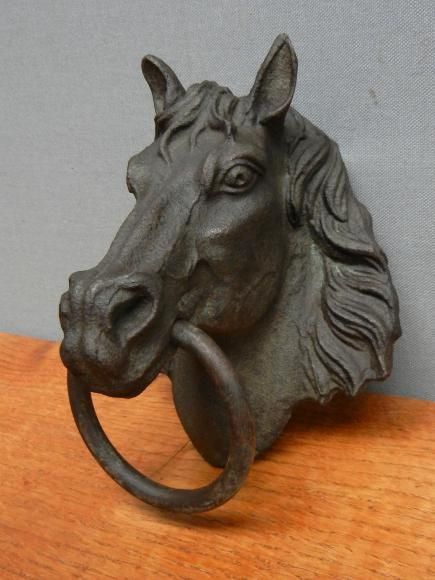 Bronze horse heads that were used to attach the reins of a horse being secured to the stable