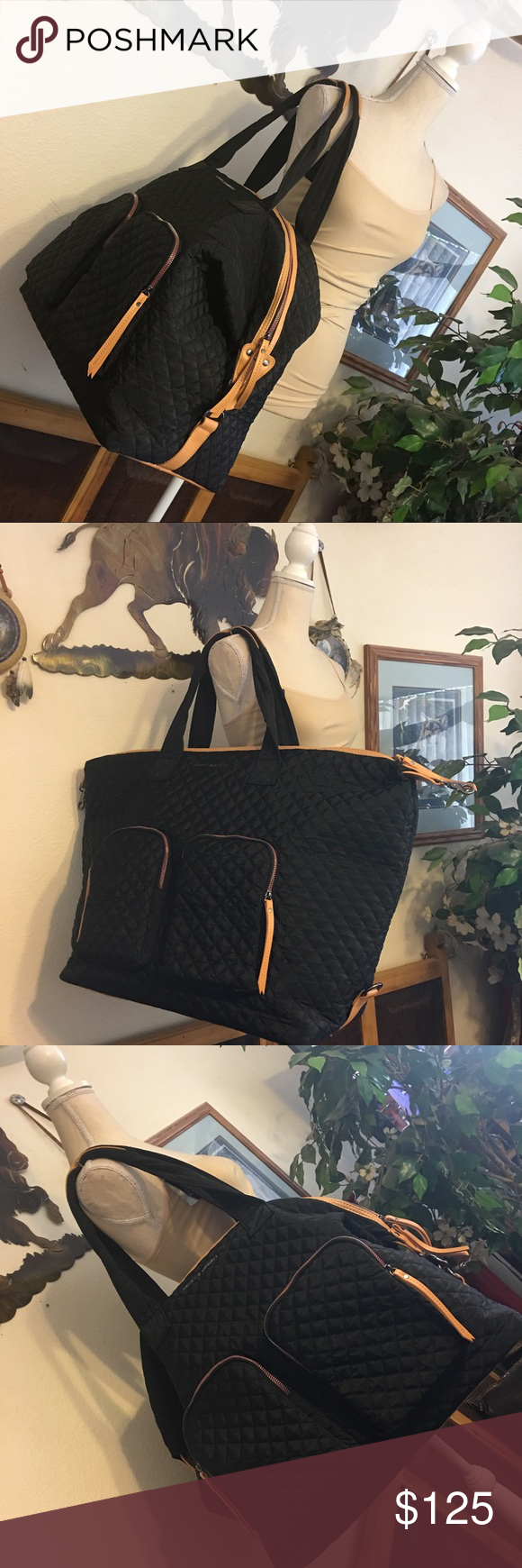 """Adrienne Vittadini large black quilted travel bag Large black quilted travel, gym or yoga bag, top corners clip down if desired, zipper top, zipper compartment inside, two zipper compartments outside front, soft and flexible bag, four metal feet on bottom, excellent condition looks brand new, no flaws and clean. 27""""Wx18""""H 10"""" handle drop Tomato red soft fabric interior, black quilted fabric exterior with golden tan leather trim Adrienne Vittadini Bags Totes"""
