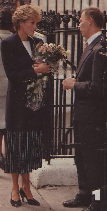 Princess Diana in a black blazer and black pinstripe skirt with white stripes. Circa 1992-4.