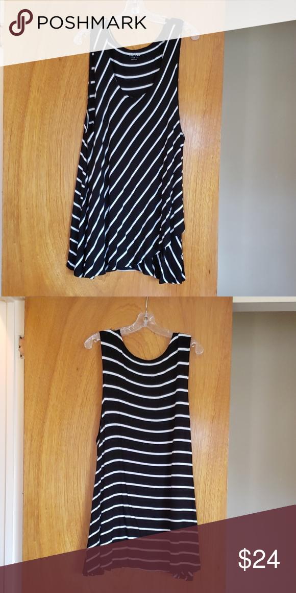 2bbaf5d8c1bb97 Women's White & Black Stripped Sleeveless Blouse Women's white and black  Stripped Sleeveless Blouse. Apt