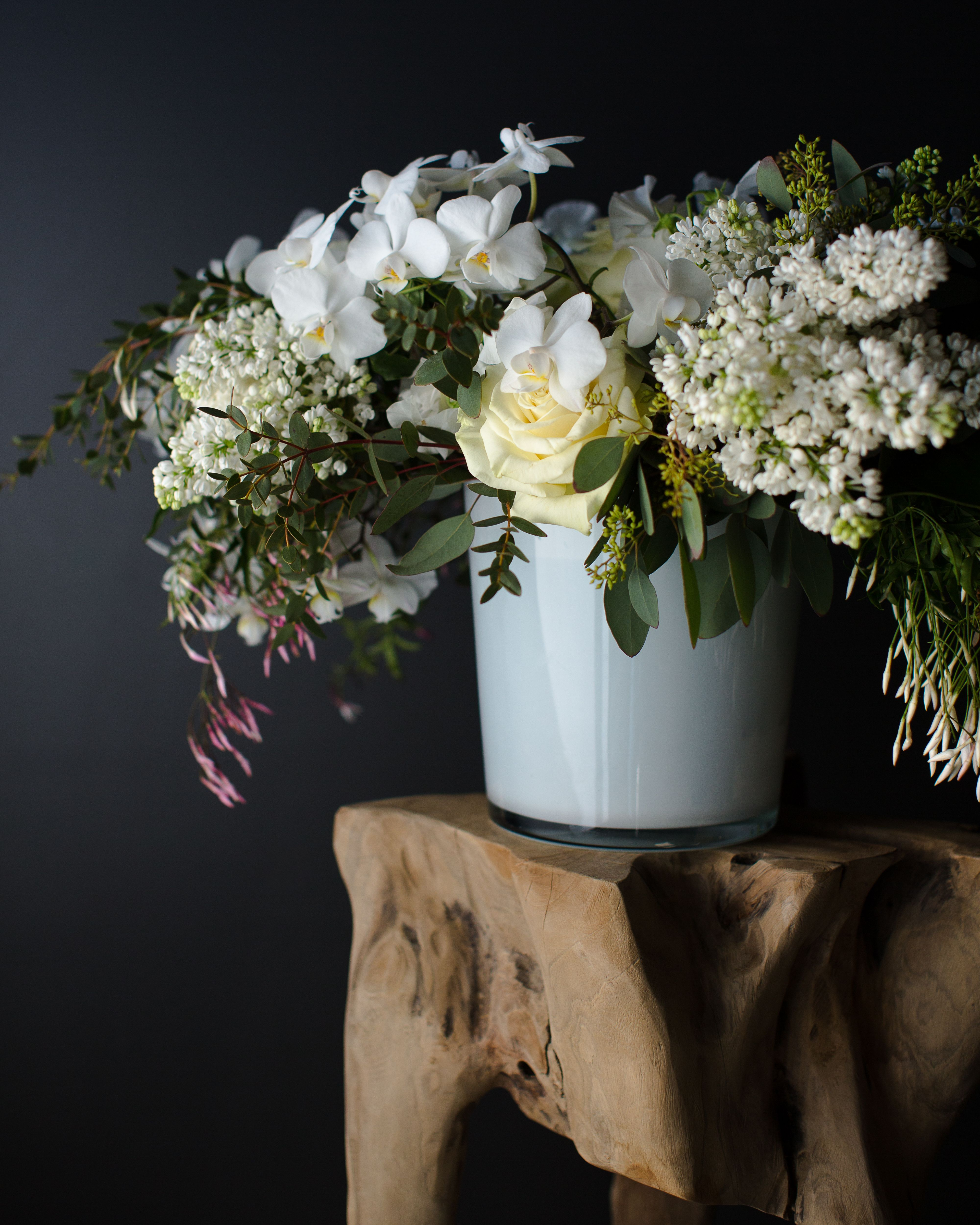 A Stunning Silhouette Of Mini White Phalaenopsis Orchids Billows Naturally Over A Base O Beautiful Flower Arrangements Same Day Flower Delivery Winston Flowers