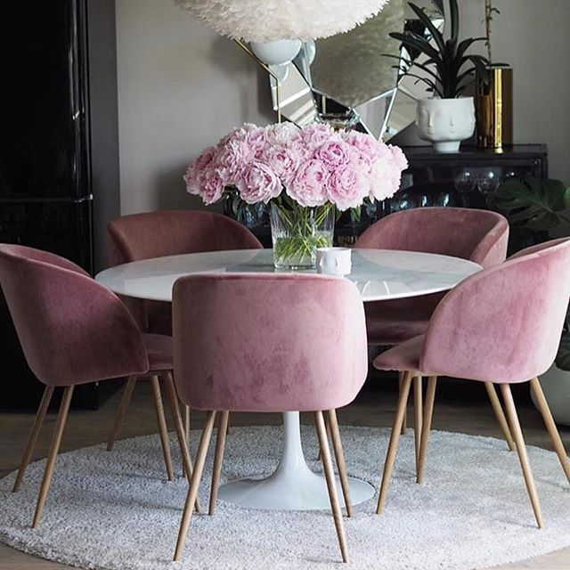 Talk about gorgeous. Round dining table set up with pink velvet ...