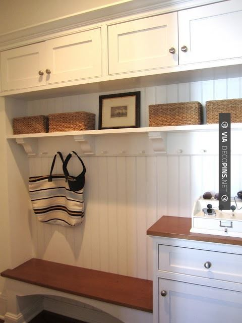 Idea: Small entry way table/chest with small lamp and mirror, next to small bench seat cabinet and hanging hooks