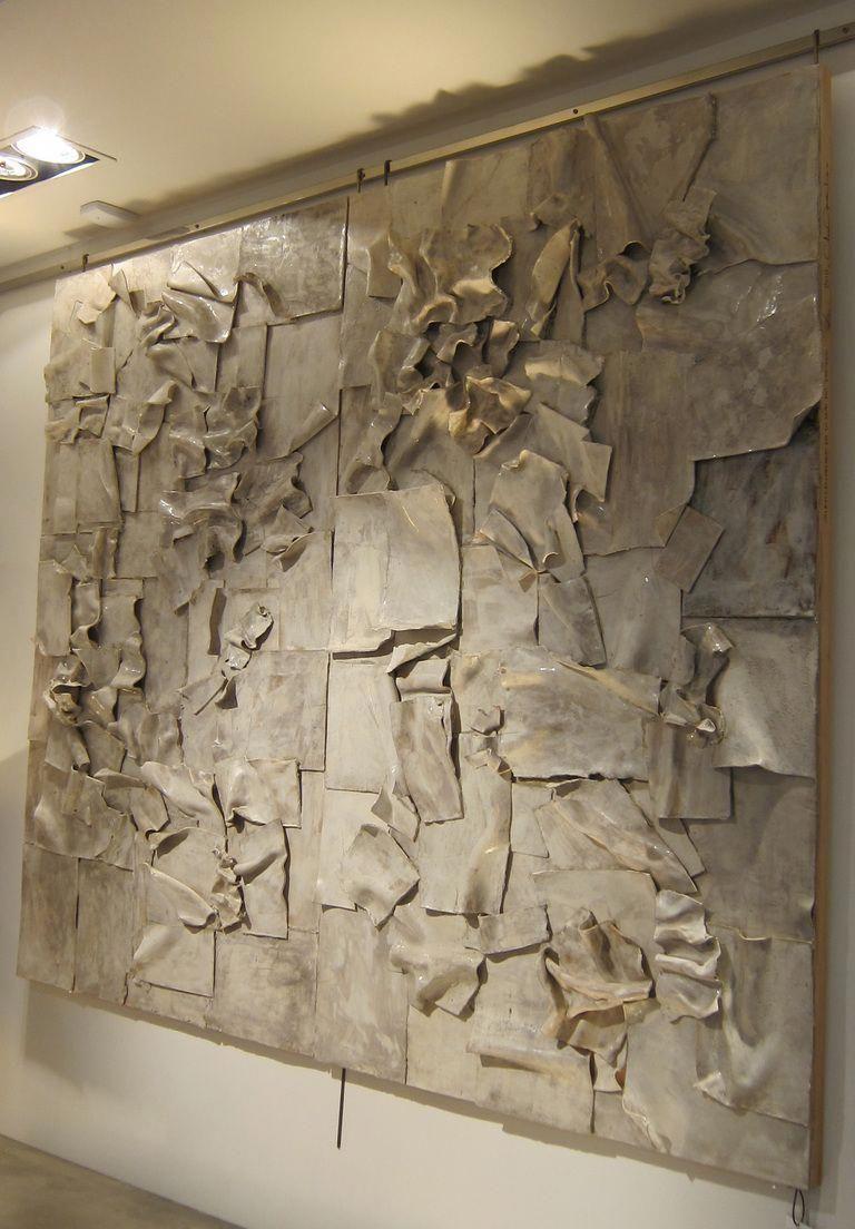 A ceramic wall sculpture by clara graziolino