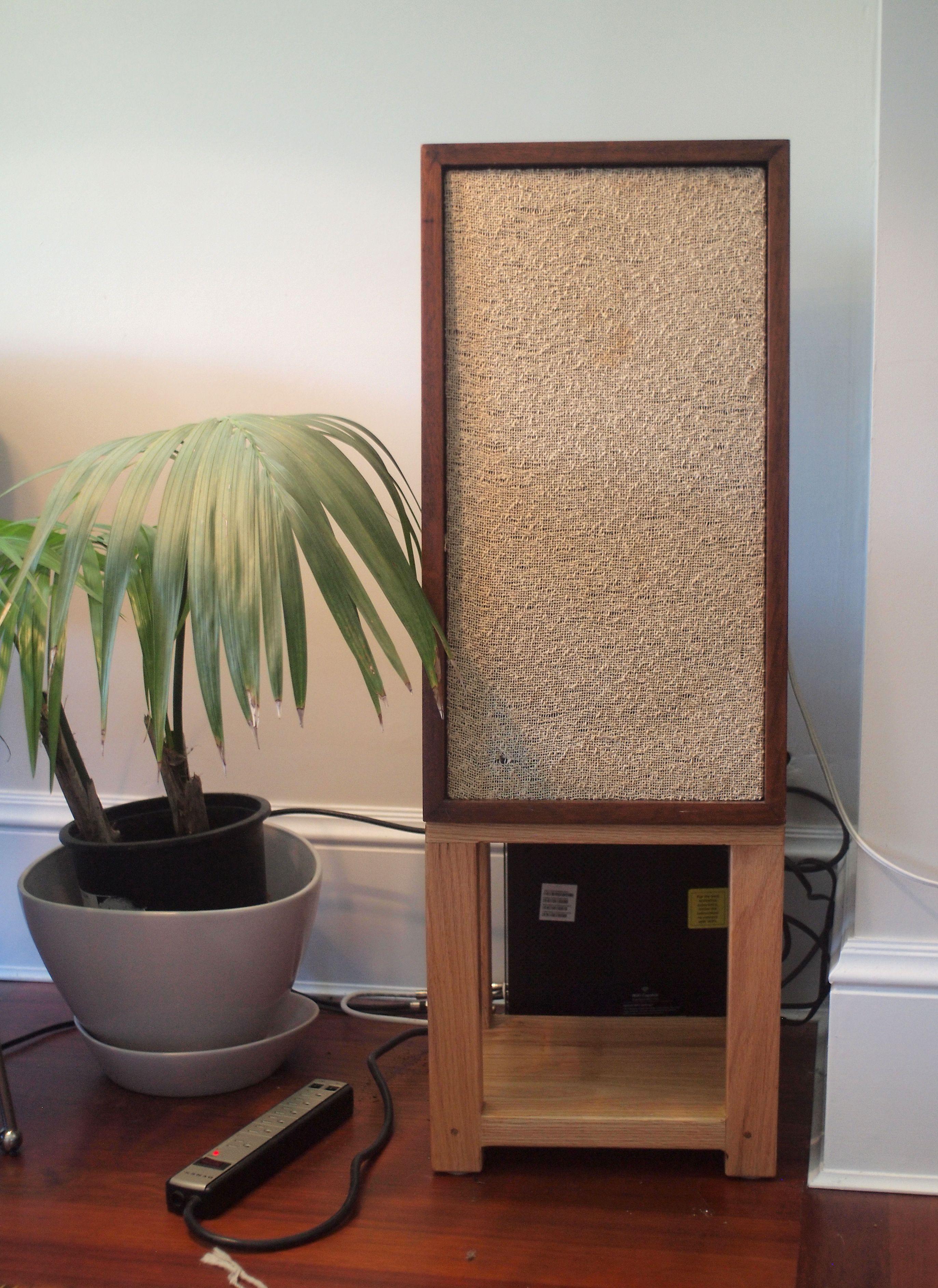Homemade solid oak speaker stands holding vintage KLH