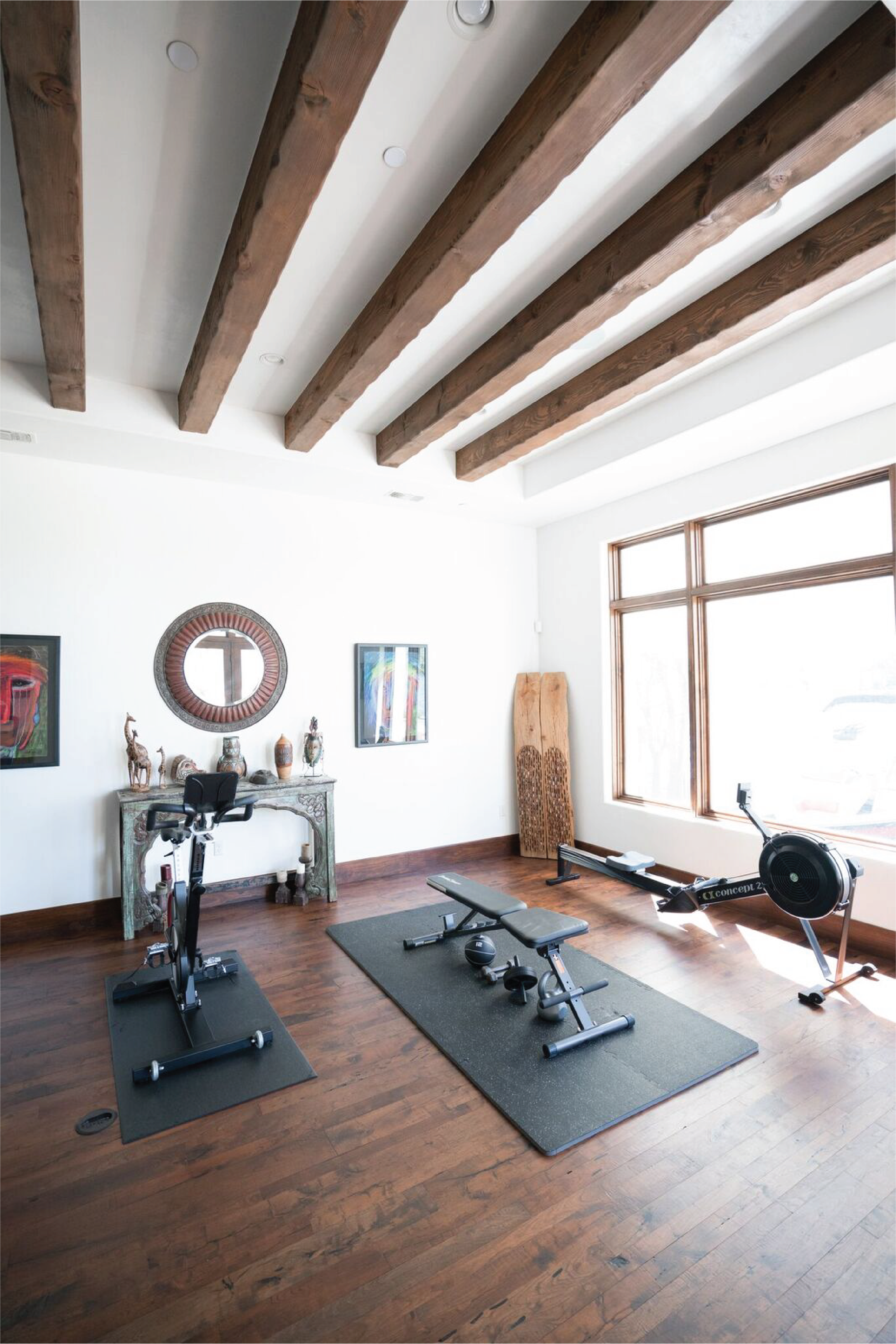Spanish style home gym rustic ceiling beams mesquite hardwood