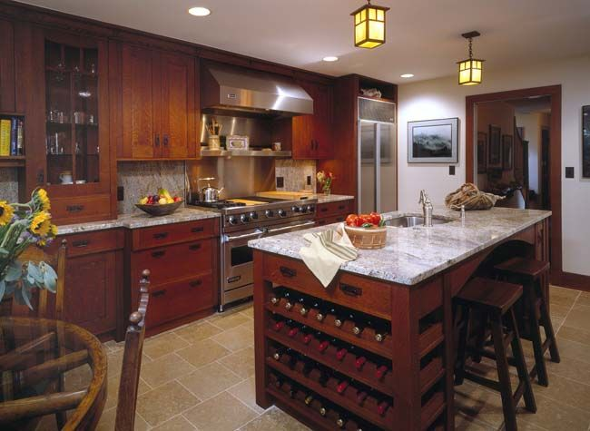 Love this Arts & Crafts kitchen with a Viking range. That island is ...