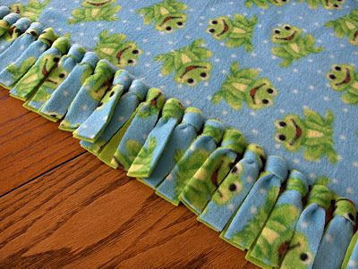 The BEST method for fleece tie blankets.  I've made dozens and love the way they turn out.  The knots come out so much better with this tie method.