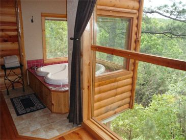 This is tree houses you can stay in at eureka springs for Tree house cabins arkansas