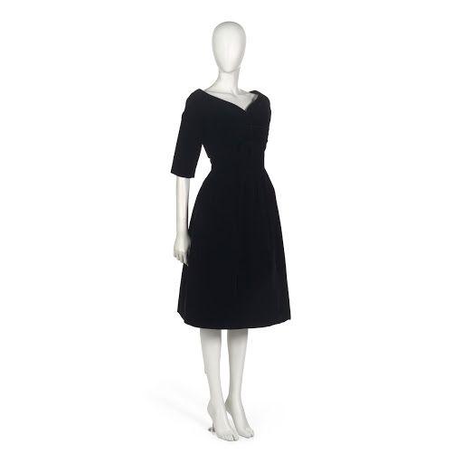 Dinner ensemble in black silk velvet comprising dress and jacket. A:  Below-knee length dress; strapless; sweetheart neckline; natural fitted  waist, self-co...
