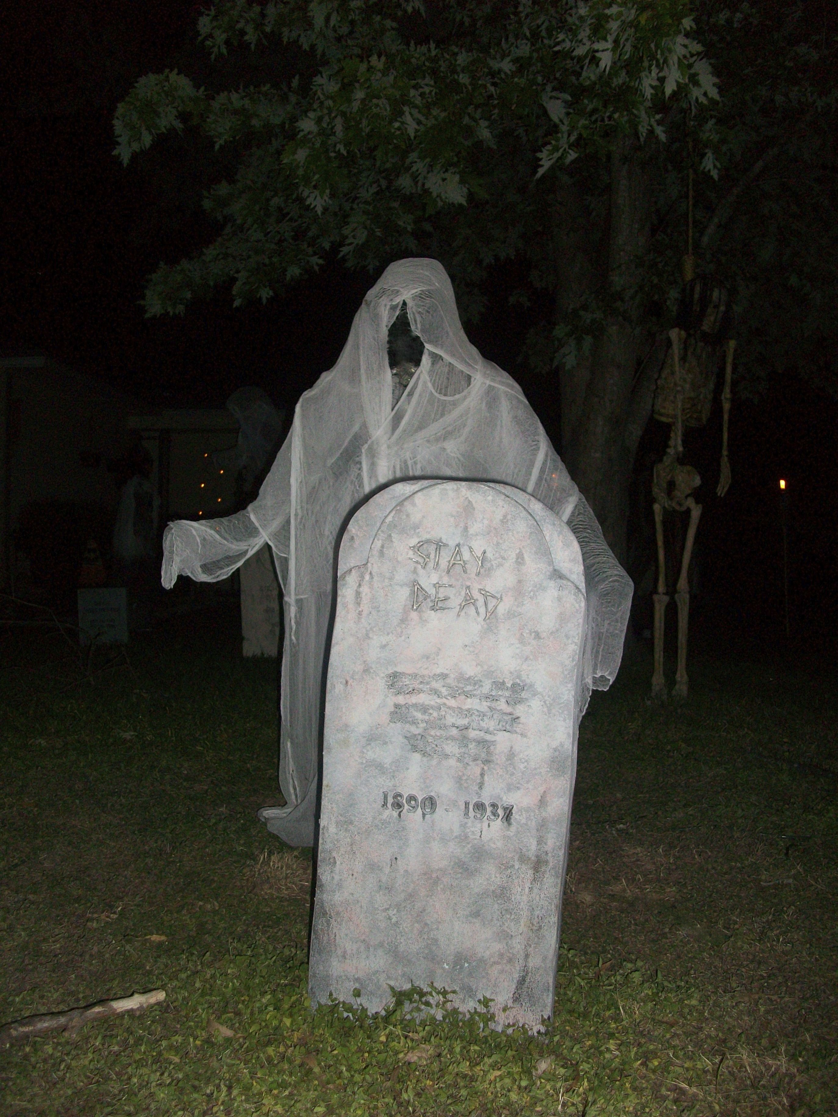 Evil Entity and tombstone Halloween graveyard, Halloween