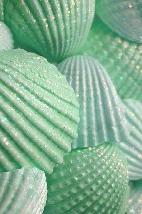 paint the shells in sea colors and sprinkle with clear glitter, put in a big vase or bowl