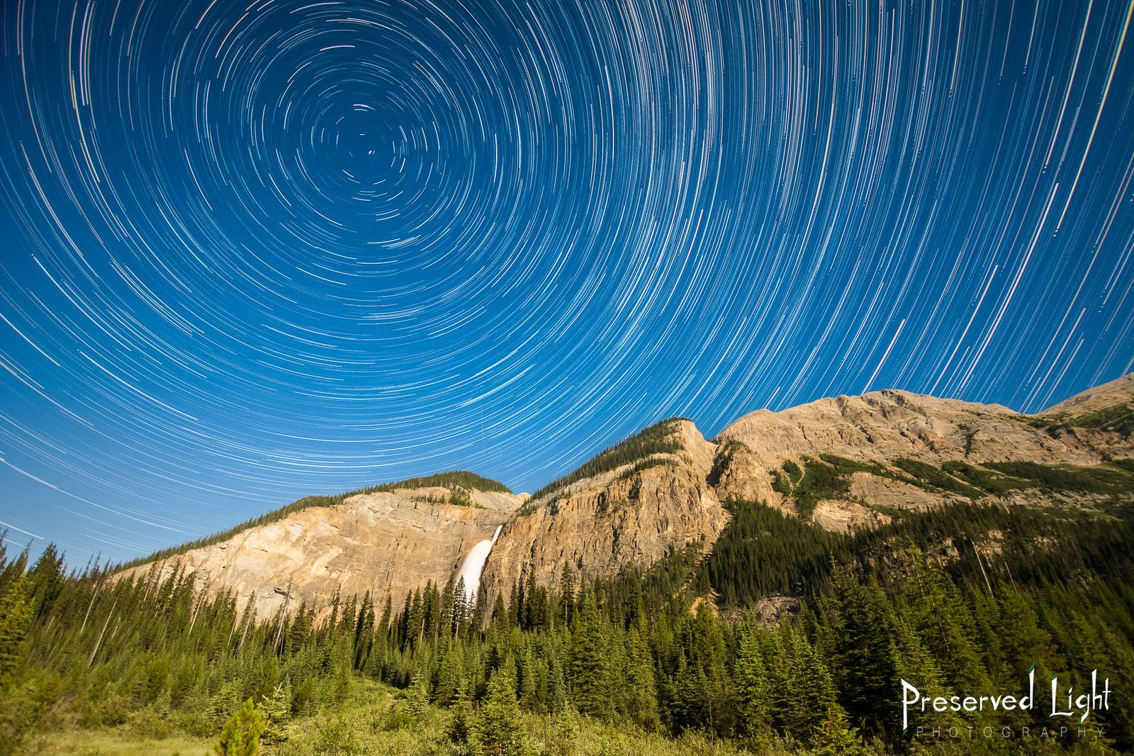 Star Trails over Yoho National Park | The more clearly we can focus our attention on the wonders and realities of the universe about us, the less taste we shall have for destruction.   ~ Rachel Carson   Photo by Caillum Smith/Preserved Light Photography | Takakkaw Waterfalls, Yoho National Park, British Columbia, Canada
