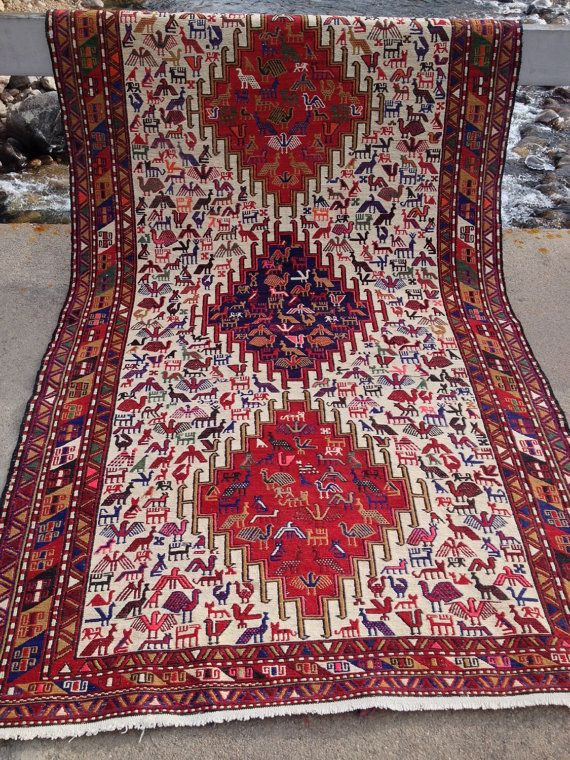 ~~~Visit my website at gypsyrugs.com ~~~ Outstanding Vintage Soumak Measures 45 x74 (+4 fringe total) This fantastic hand-knotted Soumak is covered in totemic images and woven with brilliant colors!! There are humans as well as animals that adorn this carpet. The major border has impressive pinwheels. The 3 geometric medallions in crimson red & navy blue are eye catching and assist in the structural flow of the carpet. This Soumak is in perfect condition. Its previous owner had this car...
