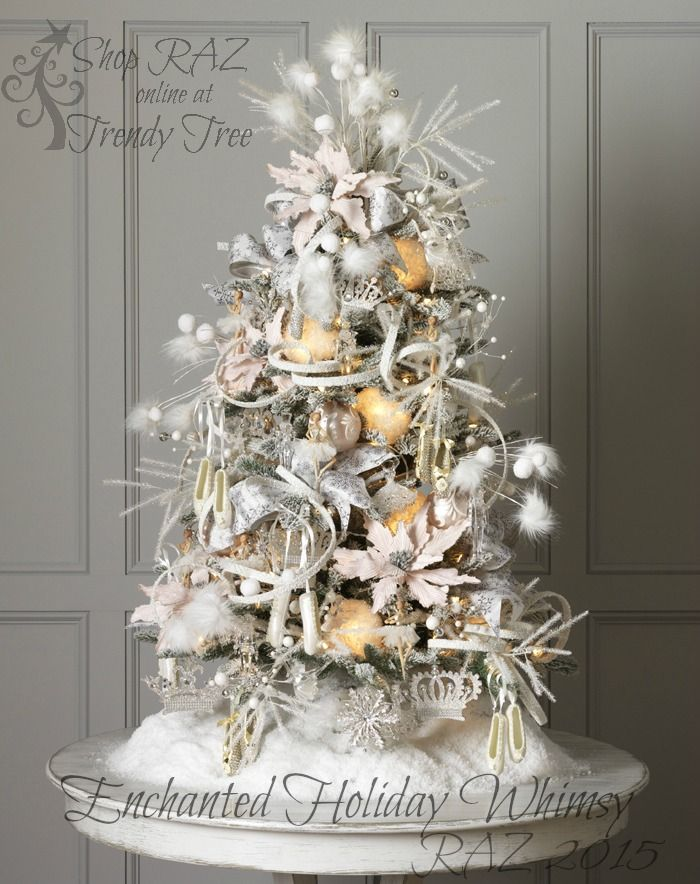 "RAZ 2015 Enchanted Holiday Whimsy Christmas Tree- the theme is ""princess ballerina"" with crowns, ballet slippers and and little tufts of fur and ribbon. I like the pale pointsettias. Still monochromatic in theme but there is a difference in color without being all white. visit http://www.trendytree.com for RAZ Christmas decorations"