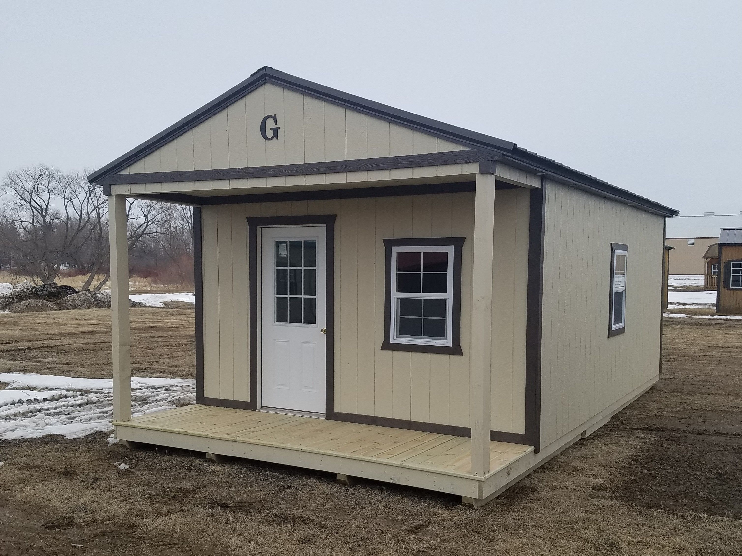 14x24 Cabin Built By Grandview Buildings Burnished Slate Metal Roof Painted Trim Lp Smartside S Pole Barn Homes Exterior Color Palette Portable Buildings