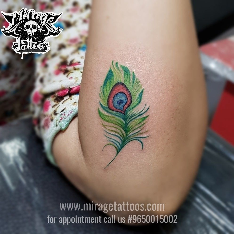 Peacock Feather tattoo. Colored Peacock feather tattoo