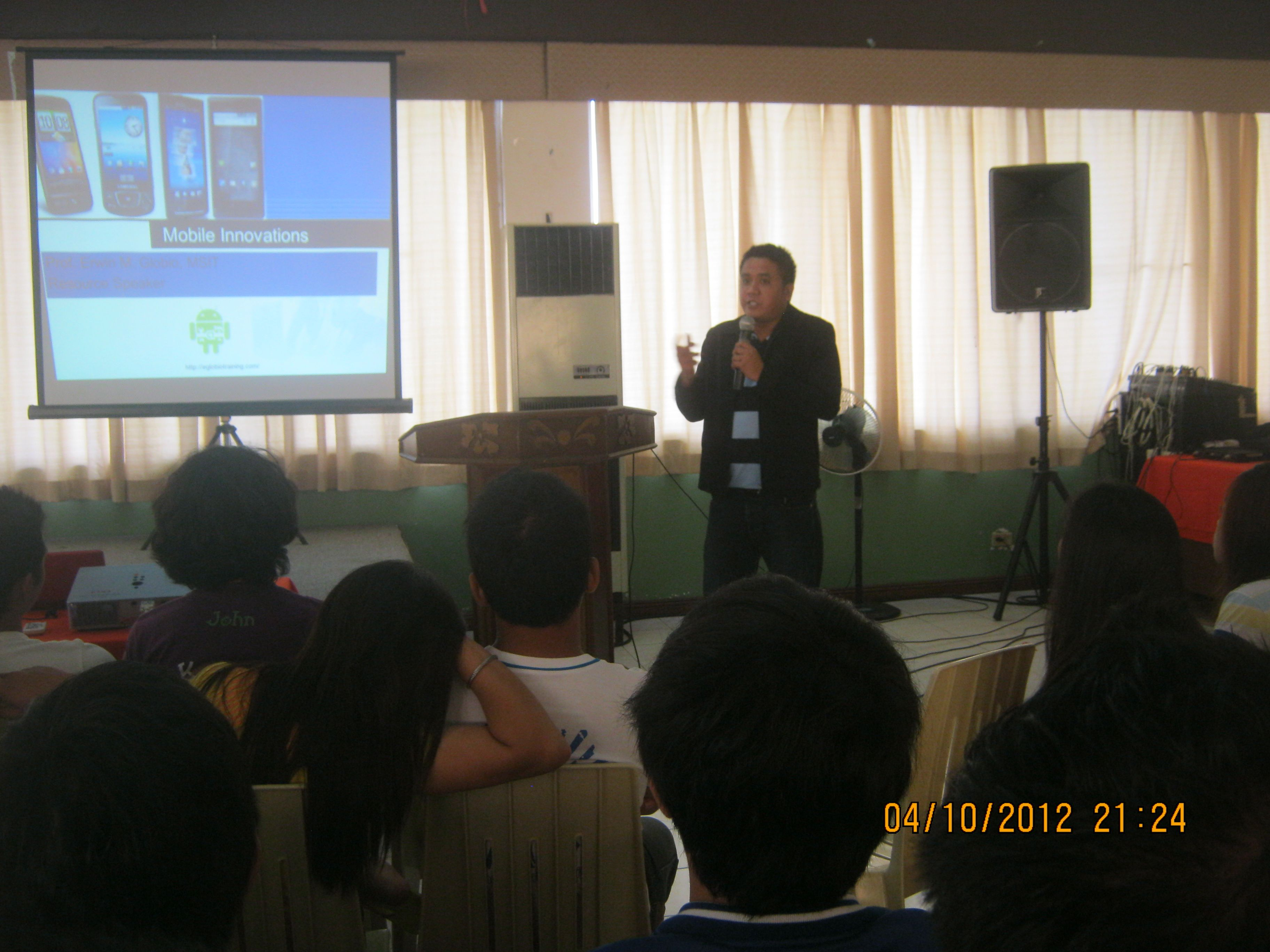 Prof. Erwin Globio speaks about Android  Mobile Programming and Games Development at the students of Don Honorio Ventura Technological State University at Caliraya Lake Resort Conference Hall.