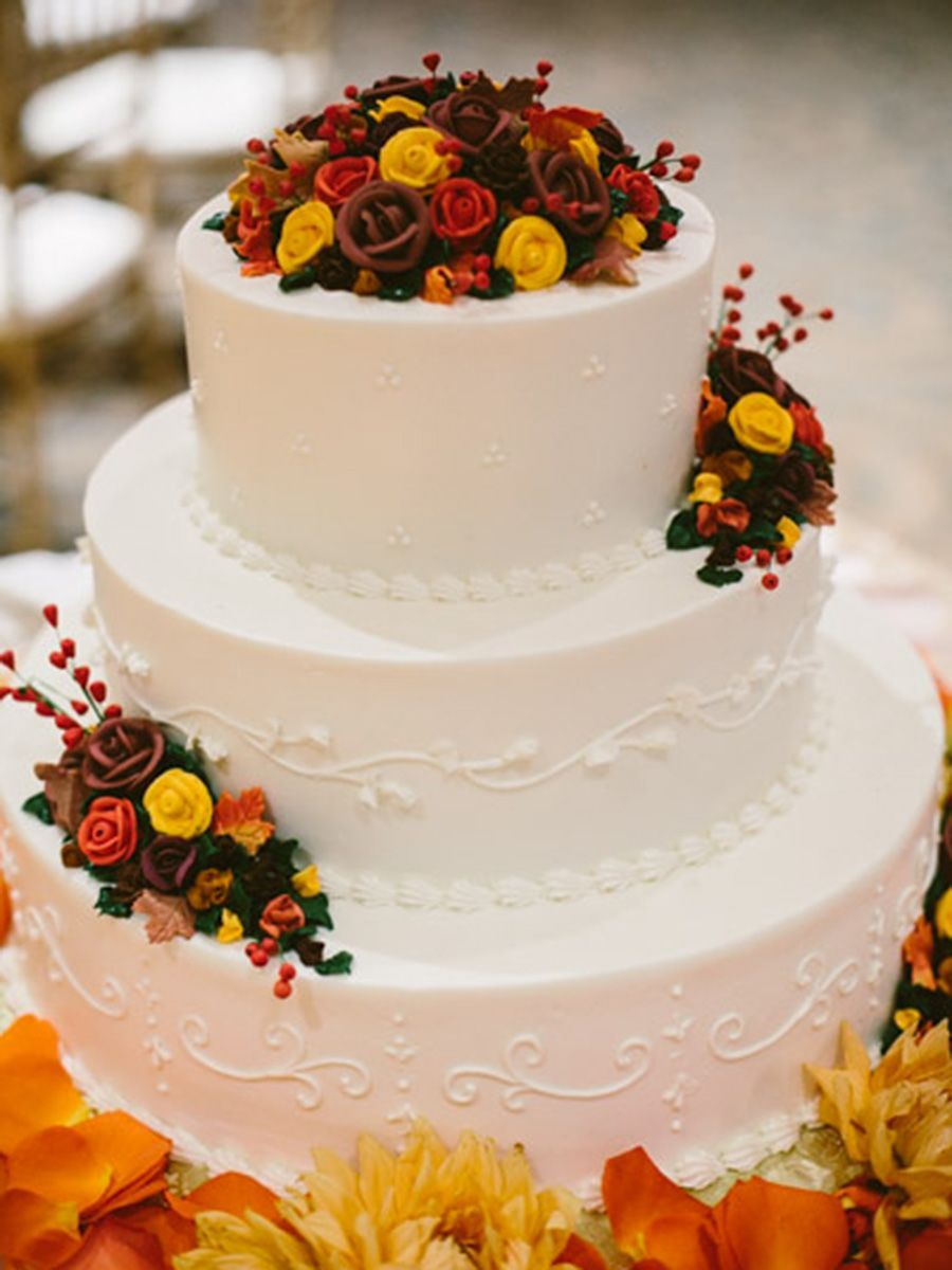 Fall wedding cake with red, orange and yellow buttercream roses ...