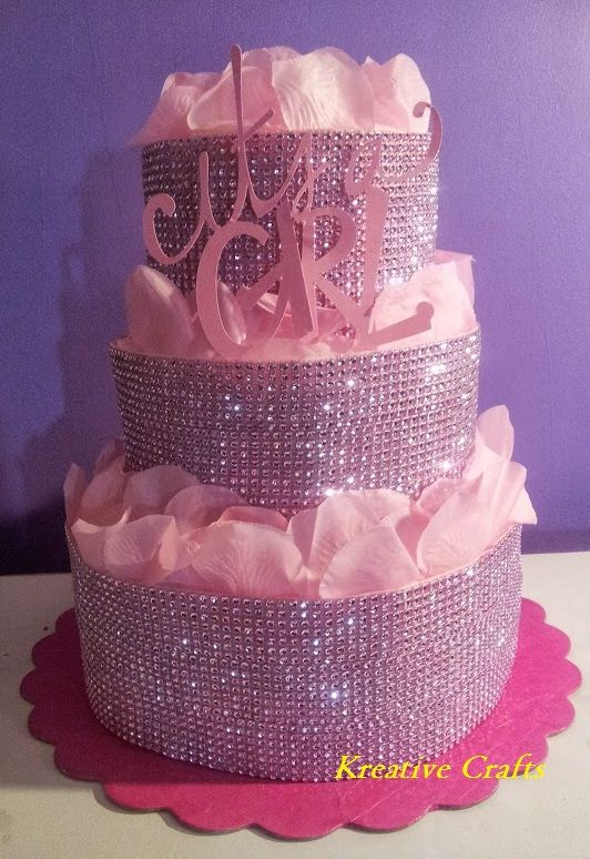 Pink Diaper Cake - Diamonds for a Baby Girl. 3 Tiers of 80 number 1 diapers. This is a hot item!! Additional items can be added inside. www.ilovekreativecrafts.com