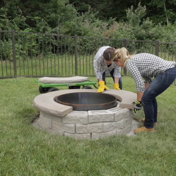 Get ready for months of outdoor entertaining around your own backyard fire pit. Build this easy DIY fire pit your whole family will enjoy for years to come. #weekendprojects #firepit #landscaping #diyfirepit #bhg